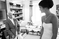 Black and white photo of bride in a strapless Vera Wang gown with loved one