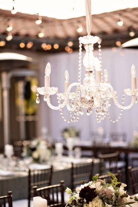 a chandelier hangs at Bacara Resort wedding