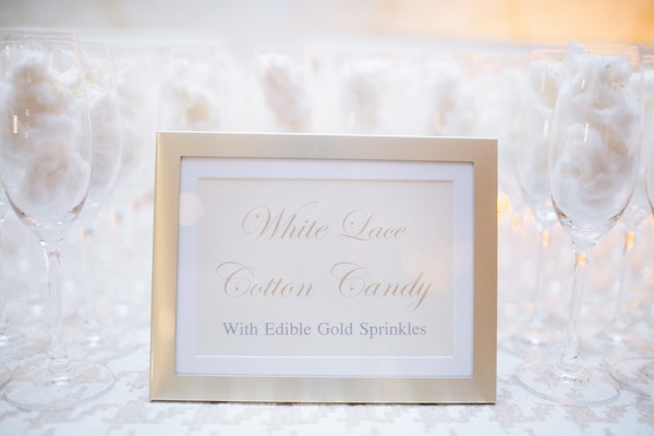 White lace cotton candy at wedding with gold sprinkles