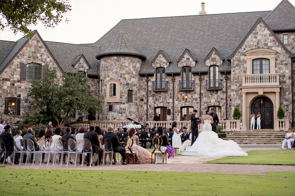 Wedding ceremony on lawn guests seated in the round large private estate in Georgia lawn ceremony