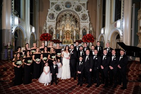 wedding party at chicago catholic church red roses black off shoulder bridesmaid dresses groomsmen