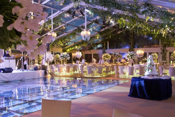 Glass A-line tent with vines and white flower chandeliers