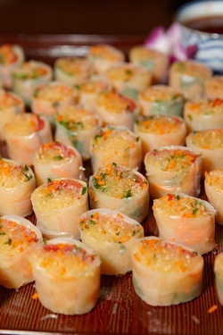 Sliced spring rolls on wood slab for wedding reception at The Ritz-Carlton Chicago