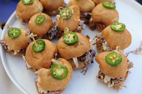 Miniature buns with jalapenos, cole slaw, and pulled pork
