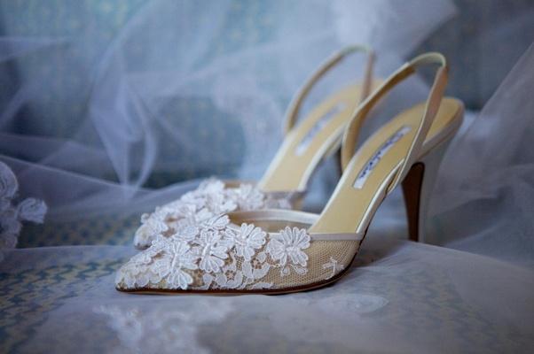 White Oscar de la Renta wedding shoes with flower details
