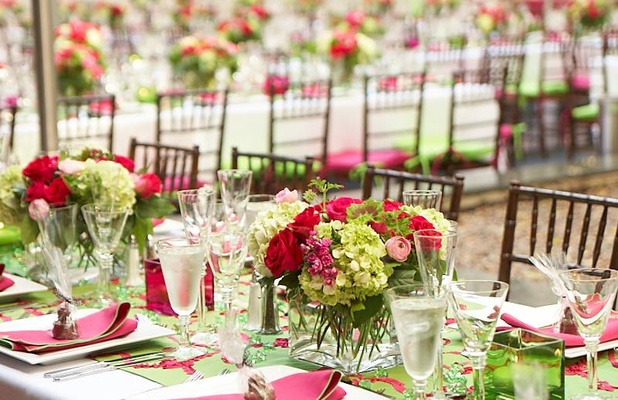 Armie hammers rehearsal dinner a stunning affair inside weddings couple smile at rehearsal dinner table overhead view of dinner tables and chairs pink and green flowers on table junglespirit Image collections