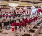 Elegant lace linens and crimson rose centerpieces