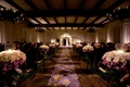 Indoor Jewish ceremony with purple accents