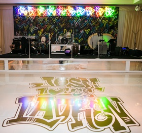 Wedding reception modern band backdrop colorful hearts neon sign graffiti lettering on dance floor