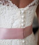 Lela Rose lace wedding gown with blush satin ribbon detail