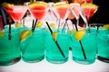 Martini glasses with watermelon and blue drinks