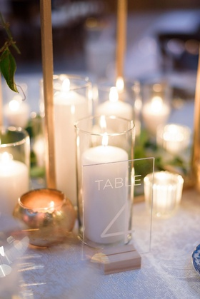 wedding reception table decor candle votives gold riser and lucite acrylic table number