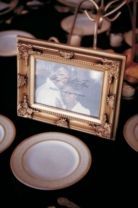 Picture of bride and groom in gold frame for wedding tables
