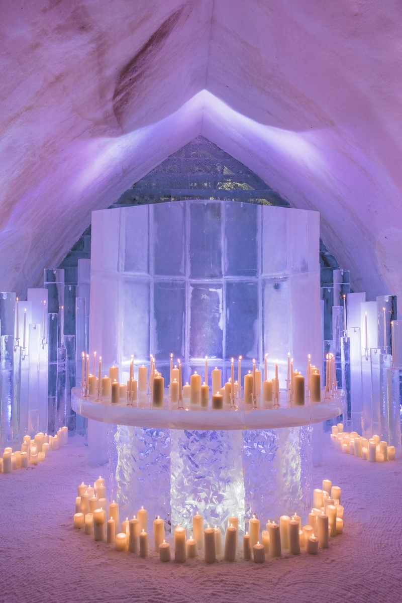 wedding ceremony ice castle altar chapel snow flooring candles of different heights