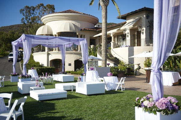 Outdoor cocktail hour furniture with light purple canopies