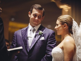 NFL football player in blue suit with bride