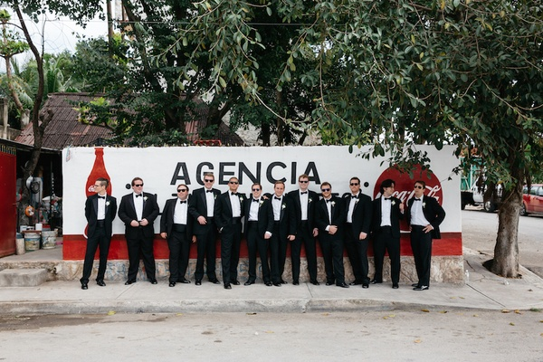 Groom and groomsmen in black tuxedos in Playa del Carmen, Mexico