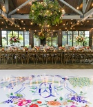 wedding reception rustic elegant white dance floor with colorful monogram pink red orange purple