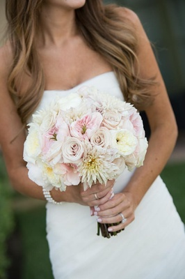 Bride holding white and pink rose flower bouquet