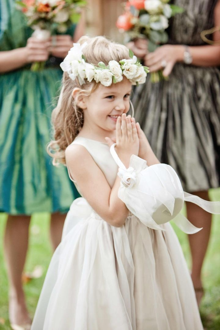 Flower girl in ivory ball gown with white basket and headband