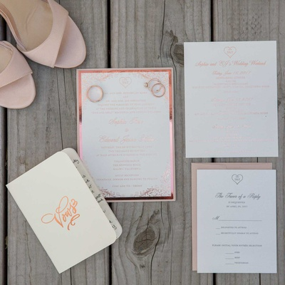 invititation suite and vow book with rose gold foil