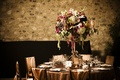 Copper reception table and chairs with bohemian floral arrangement