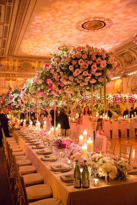 Wedding reception at The Plaza Hotel with tall pink and greenery centerpieces flower runner candles
