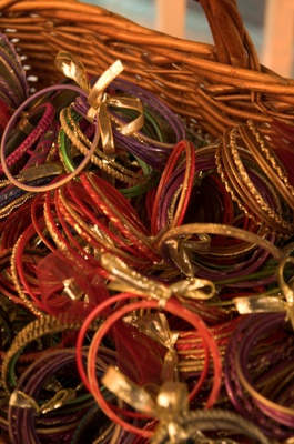 India bracelets tied with gold ribbons