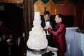 White wedding cake with each layer inspired by a Matthew Christopher wedding dress design
