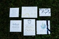 Wedding invitation suite navy and gold monogram calligraphy foil ceremony program watercolor detail