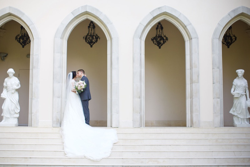 Bride and groom kiss on steps of Chateau in Houston, Texas wedding venue ideas