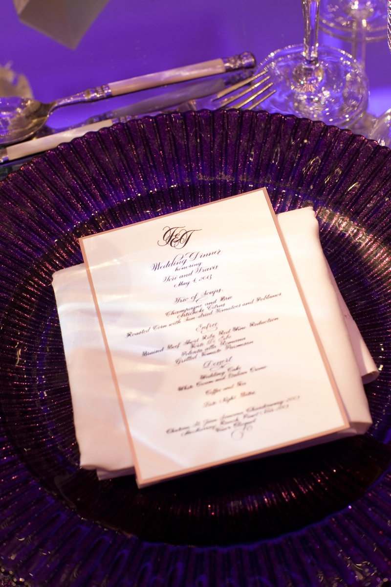 White and gold menu card with purple charger plate