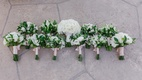 white roses bridal bouquets, bridesmaids bouquets with white flowers and greenery