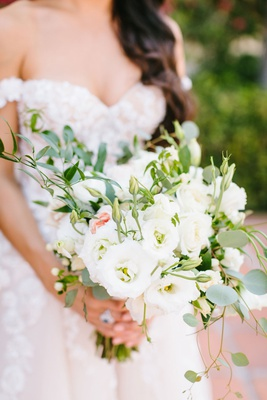 bride in off shoulder galia lahav ball gown with neutral bouquet greenery white flower touch of pink