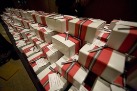 White favor boxes with red and black ribbon bows
