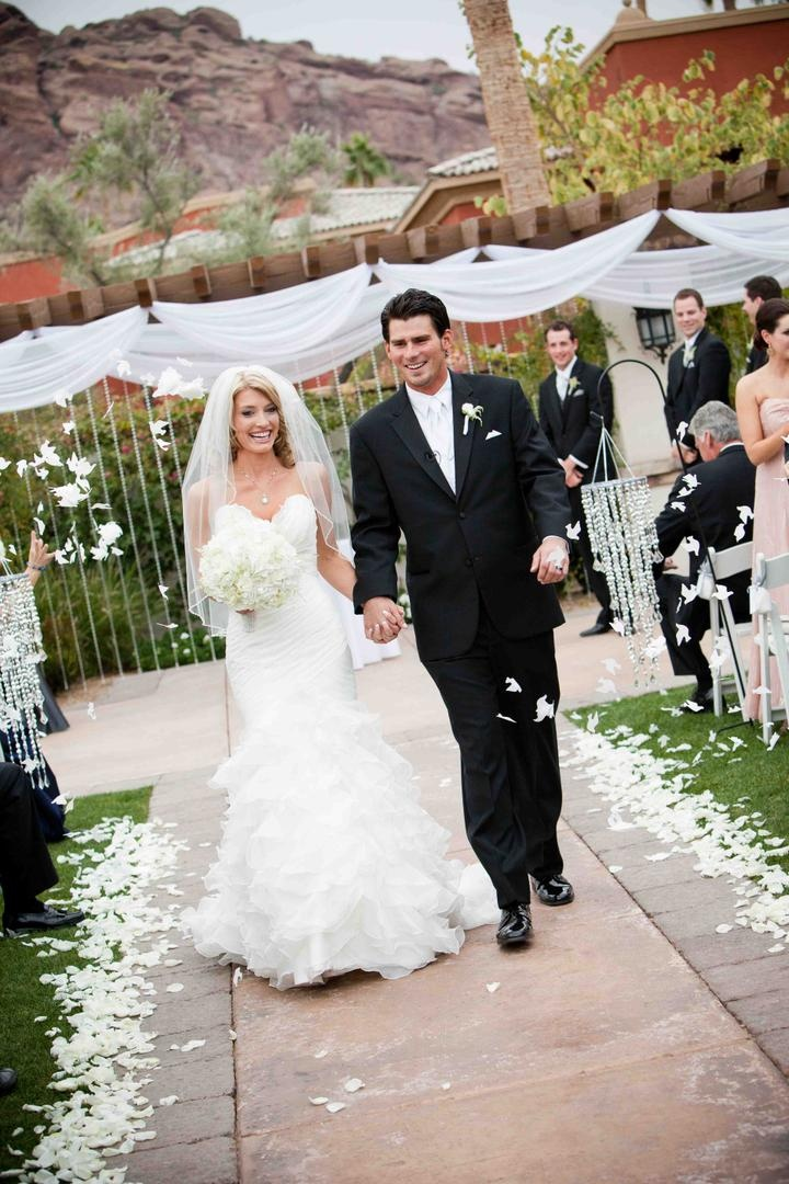 MLB player Brandon Wood exiting ceremony with wife