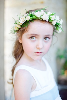 Flower girl with curled pony tail and floral headpiece