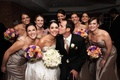 Bride and groom with bridesmaids at reception