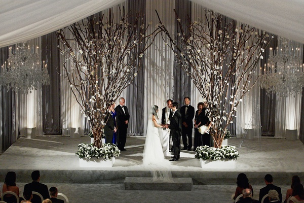 Indoor Chicago wedding with tree branch ceremony structure