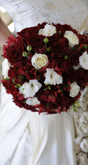 Wedding bouquet with rose, alstroemeria, and berries