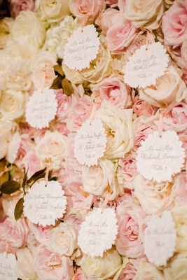 wedding escort cards flower shape with pink white rose flower wall jackson durham events