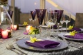 Metallic linens and charger plate at wedding reception