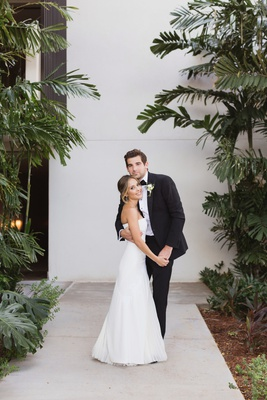 bride in j. mendel wedding dress, groom in ralph lauren purple label tuxedo