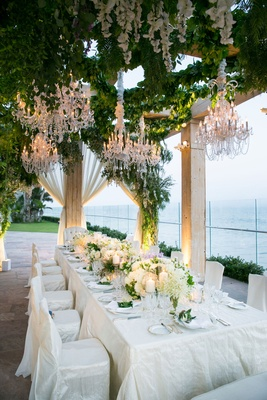 Wedding reception dinner table one table intimate wedding chandeliers greenery white lavender flower