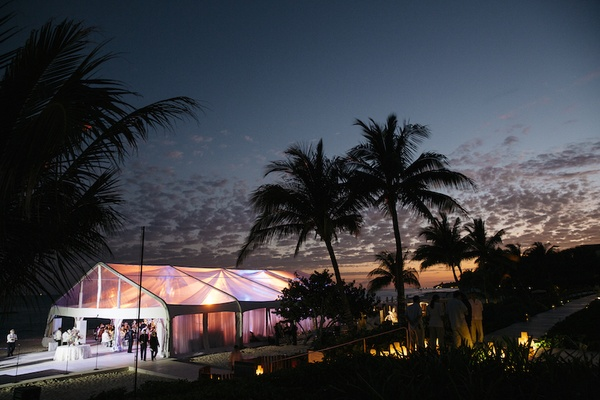 Tented wedding reception with purple lighting in Playa del Carmen, Mexico