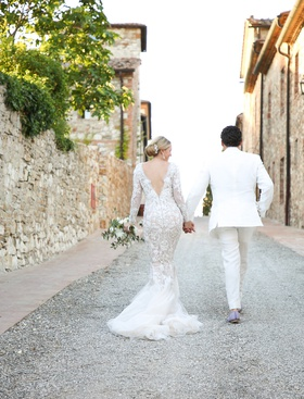 bride in marchesa wedding dress long sleeves v back mermaid, groom in white tuxedo, tuscan road