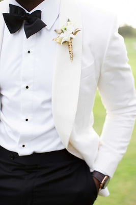 white suit jacket, boutonniere with gold detailing DeMarco Murray wedding attire