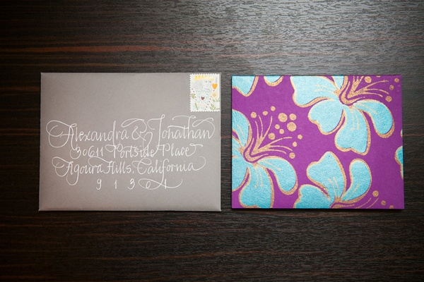 Grey and white invite envelope and floral motif