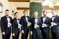 groom and groomsmen with custom beer steins with caricatures