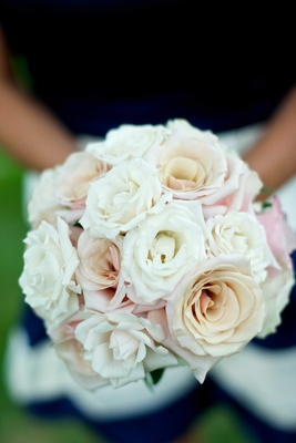 Bridesmaid bouquets of white and pale pink roses